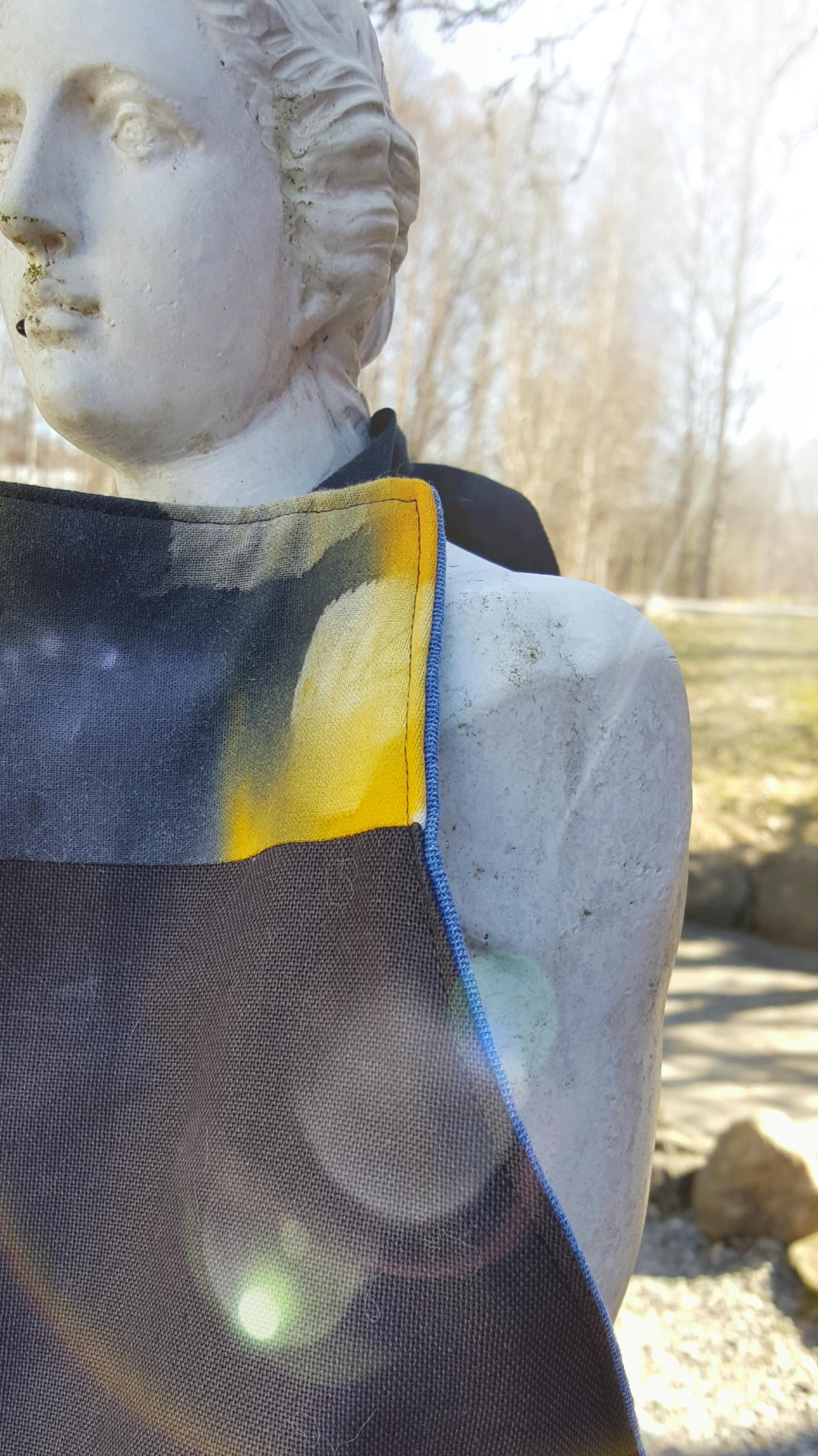 Detalj av förkläde med soltryck